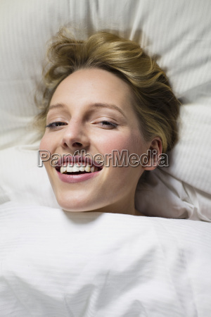 young woman under duvet head on