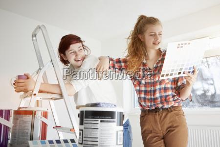 two teenage sisters preparing to decorate