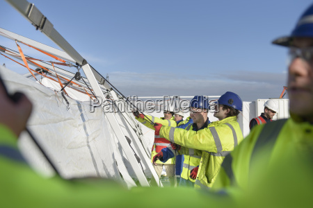 emergency response team workers erecting tent