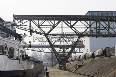 container ship cranes and freight train