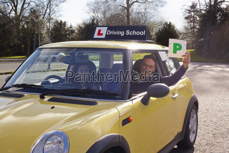 driving instructor holding passed plate out