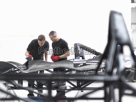engineers inspecting carbon fibre car body