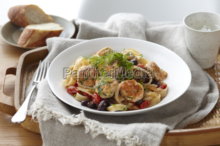 bowl of linguine and salmon polpette