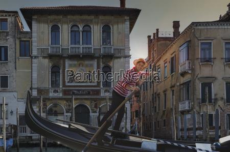 gondolier on grand canal venice veneto