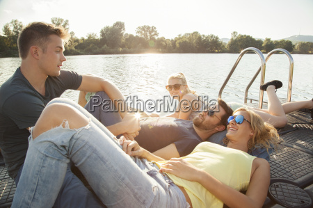 four young adult friends chatting on