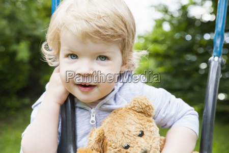 portrait of female toddler playing on