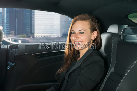 young businessman traveling in the car