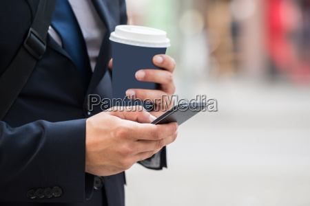businessperson hand with mobile phone and