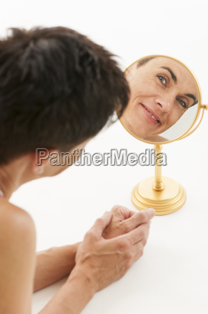woman in the mirror on whitevertical