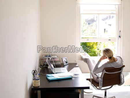 woman sitting in sunny home office
