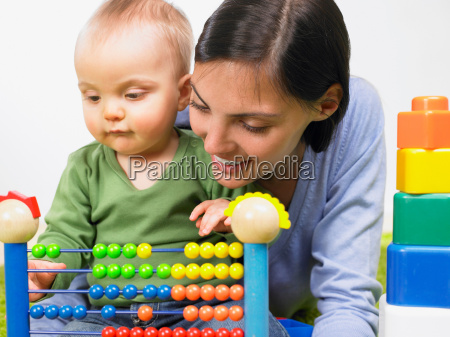 mother and baby boy playing