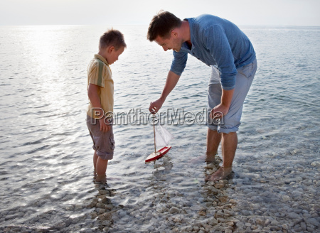 father and son with toy boat