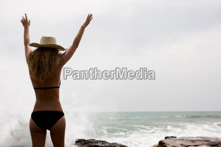 girl with arms up in front