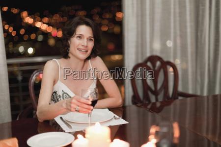 woman having romantic dinner at home