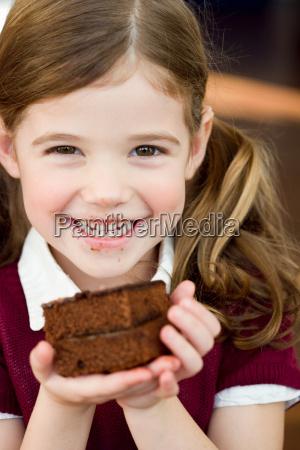 girl holding an chocolate cake