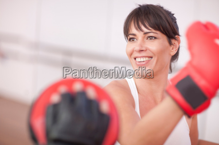 mid adult woman training in gym