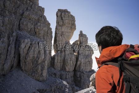 climber looking at rocky walls brenta