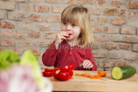 two year old girl in kitchen