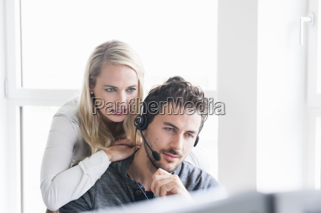 woman leaning on mans shoulder man