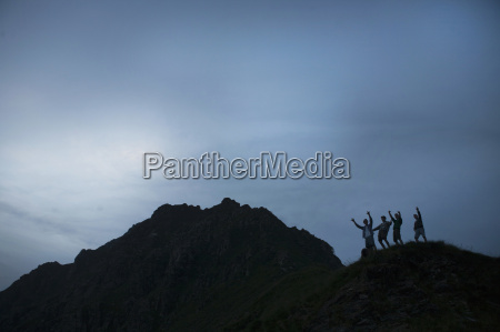 silhouette of four young adult men