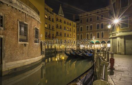 canal and gondolas at night venice