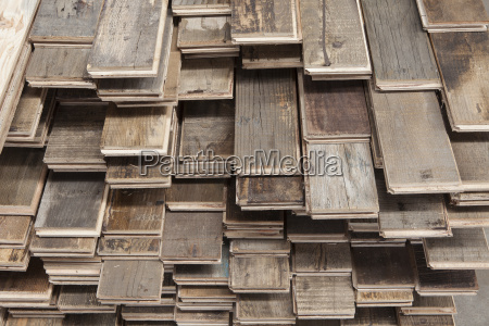 stacks of treated wood flooring in