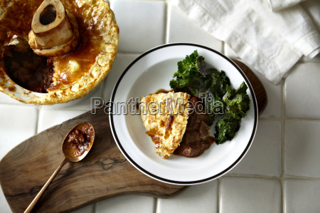 bowl of pot pie and cabbage
