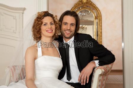 young bridal couple smiling portrait