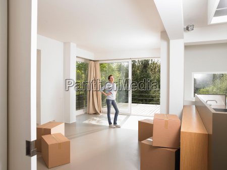 young woman contemplating her new place