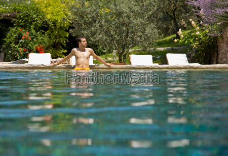 man wading in the pool
