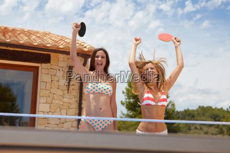 two winning women at ping pong