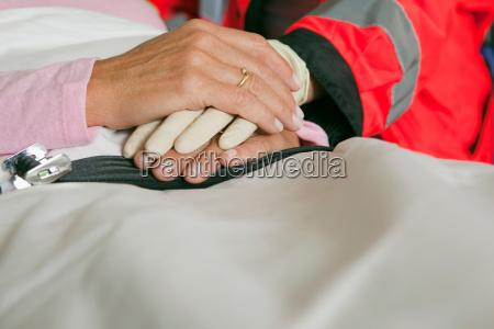 hands of ambulance woman caring