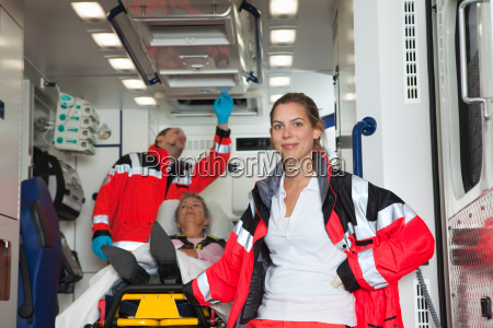 ambulance team with patient in coach