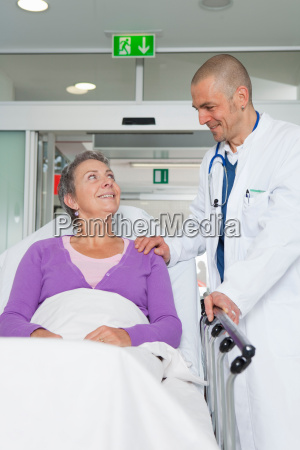 doctor caring for elderly woman