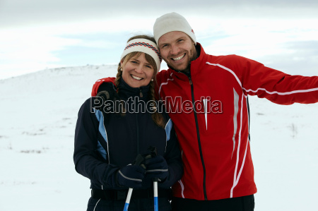 couple hugging on snowy mountain