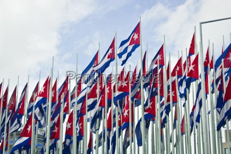 group of cuban flags against blue