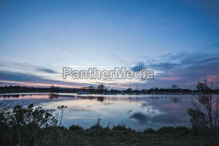 blue sky reflected in still rural