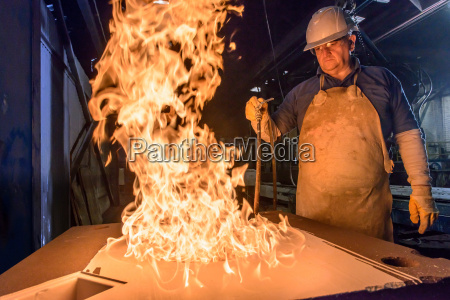 worker using flames to cure a