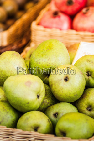 close up of basket of pears
