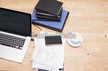 laptop with books and coffee cup