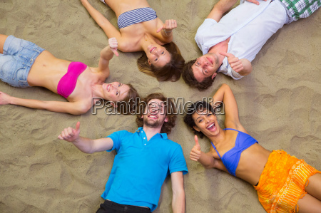 aerial view of friends lying with