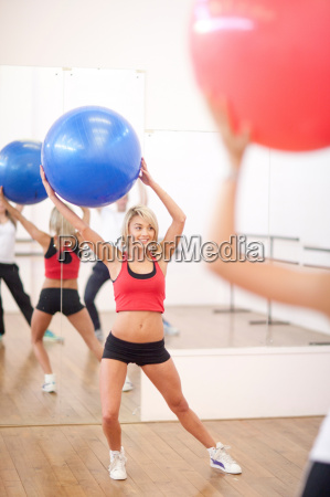 young woman with exercise ball in