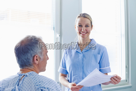nurse having conversation with patient