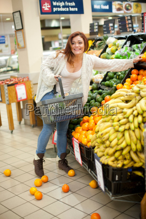 young woman having shopping mishap with