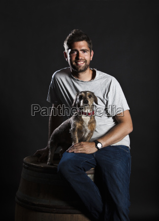 portrait of winemaker and his dog