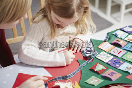 mother and daughter making advent calendar