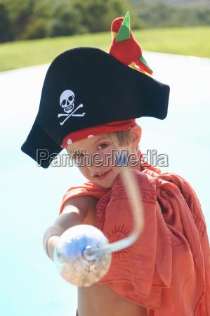 portrait of boy in pirates hat