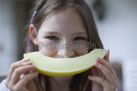 portrait of girl with melon slice