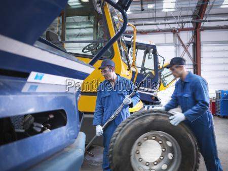 engineers prepare to fix wheel in