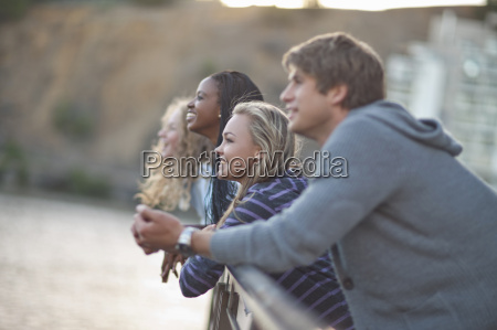 four young adult friends gazing from
